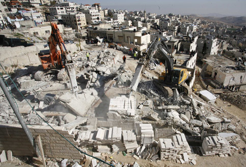 Israeli bulldozers demolish a Palestinian house in the village of Issawiya, on the edge of Jerusalem, 25 December 2006