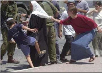 settler harrassing Palestinian