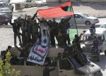 Libyan army soldiers and protesters shout anti-Gaddafi slogans in Tobruk
