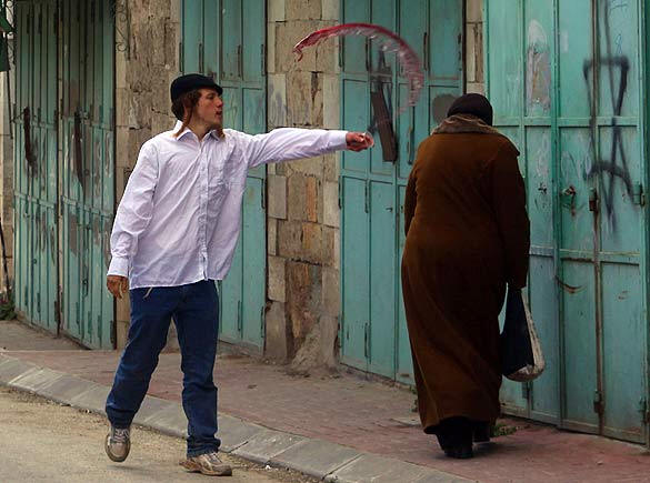 jewish-thug-throwing-wine-on-a-palestini